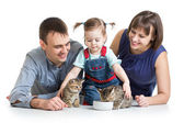 Child girl and her parents feeding small kittens — Stock Photo