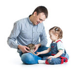 Kid girl and her father play with cat kitten — Stock Photo