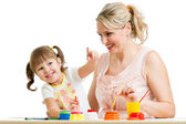 Mother and child paint together — Stock Photo