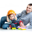Baby girl and father play toys together — Stock Photo