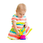 Child is playing with toys — Stock Photo