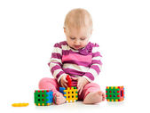 Cute little child is playing with toys — Stockfoto