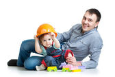Baby girl and father play toys together — Stockfoto