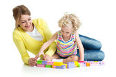 Kid and mother playing together with construction set toy — Stock Photo