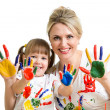 Mother with kid showing painted palms — Stock Photo