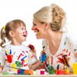 Stock Photo: Mother with kid painting and have fun pastime