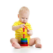 Baby boy playing with pyramid toy — Stock Photo
