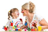 Mother with kid painting and have fun pastime — Stok fotoğraf
