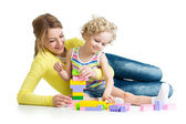 Kid and mother play toys together — Stock Photo