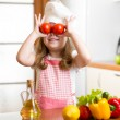 Funny chef girl preparing healthy food at kitchen — Stock Photo #40965323