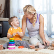 Stock Photo: Mother and kid play indoor