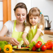 Mother and kid cooking — Stock Photo