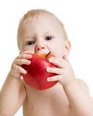 Baby boy eating apple — Stock Photo
