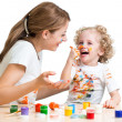 Dirty mother and kid girl painting together — Stock Photo #41084653