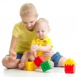 Kid girl playing with her little brother — Stock Photo #41084761