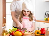 Mom and child cooking at kitchen — Stock Photo