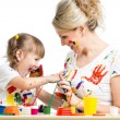 Stock Photo: Kid with parent paint together
