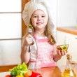 Chef girl preparing and tasting healthy food over white backgrou — Stock Photo #41250429
