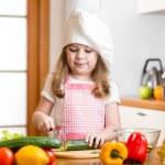 Chef girl preparing healthy food at kitchen — Stock Photo