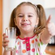 Kid drinking milk from glass — Stockfoto