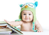Baby in funny knitted hat owl with books  on white background  — Stock Photo