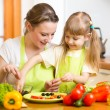 Mother and kid daughter cooking in kitchen  — Stock Photo #41527373