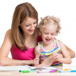 Mom and child painting together — Stock Photo #41527375
