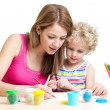 Mother and kid girl painting together — Stock Photo #41527381