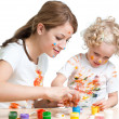 Mother and kid girl painting together — Stock Photo #41527387