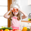 Funny chef girl cooking at kitchen — Stock Photo #41527409