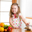 Stock Photo: Child refusing harmful food in favor of vegetables
