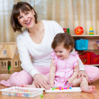 Happy mother and kid play together — Stock Photo #41527449