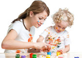 Mother and kid girl painting together — Stok fotoğraf