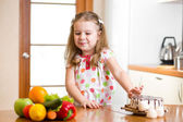 Child refusing harmful food in favor of vegetables — Stock Photo