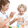 Mother and kid girl painting together — Stock Photo #41742371