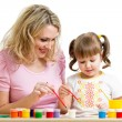Stock Photo: Mother and kid girl painting together