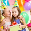 Pretty children giving gifts on birthday party — Stock Photo #41742417