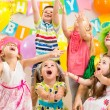Children group with clown celebrating birthday party — Stock Photo