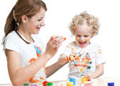 Mother and kid girl painting together — Stock Photo