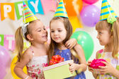 Pretty children giving gifts on birthday party — Stock Photo
