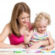Stock Photo: Mother and child painting together