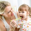 Mother teaches kid teeth brushing — ストック写真 #41965981
