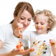 Mother and kid girl painting together — Stock Photo #41965983