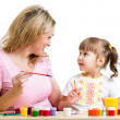 Mother and kid girl painting together — Stock Photo #41965991