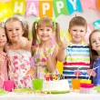 Stock Photo: Kids preschoolers celebrating birthday party
