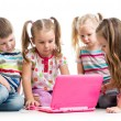 Stock Photo: Group of children friends at laptop