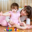 Stock Photo: Happy mother and kid play together