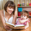 Mother reading book to child at home — Stock Photo #41966061