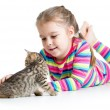 Foto Stock: Kid girl stroking cat kitten