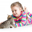 Стоковое фото: Kid girl stroking cat kitten
